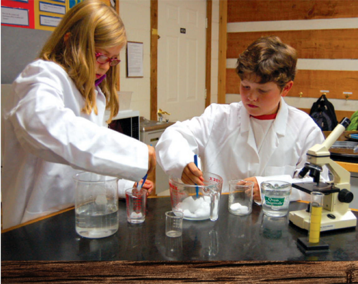 Two fourth graders conducting a science experiment.