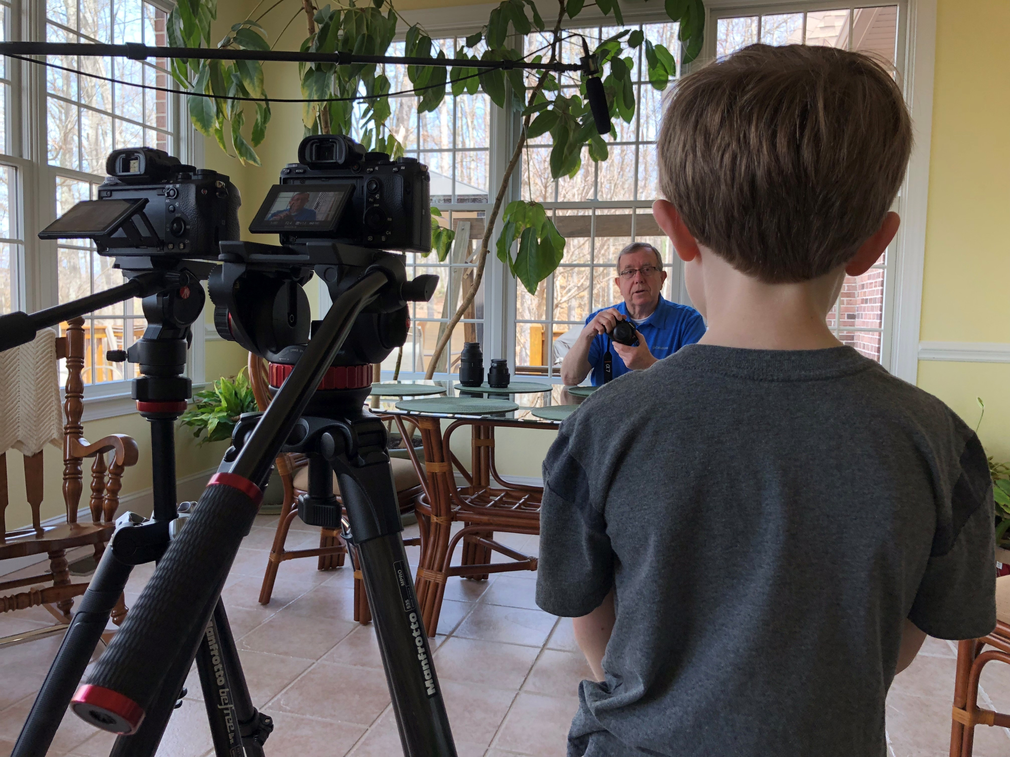 Photo of Aiden Barger filming documentary.